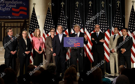 Attorney Theodore Olson, center at podium, speaks at a news conference in San Francisco, . Also pictured from left are San Francisco city attorney Dennis Herrera, attorney Therese Stewart, Sandy Stier, Kris Perry, attorney David Boies, Chad Griffen, director of the American Foundation for Equal Rights, Paul Katami, and Jeff Zarrillo. Stier and Perry, and Katami and Zarrillo, were the two same-sex couples who were plaintiffs in a federal court case on California's same-sex marriage ban. A federal judge overturned California's same-sex marriage ban Wednesday in a landmark case that could eventually land before the U.S. Supreme Court to decide if gays have a constitutional right to marry in America