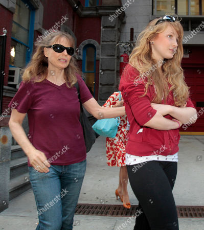 Caroline Giulliani, Donna Hanover Caroline Giuliani, 20, right, and her mother Donna Hanover leave the 19th precinct in New York. A law enforcement official says Rudy Giuliani's daughter was arrested after she was seen on video pocketing makeup at a New York City cosmetic store