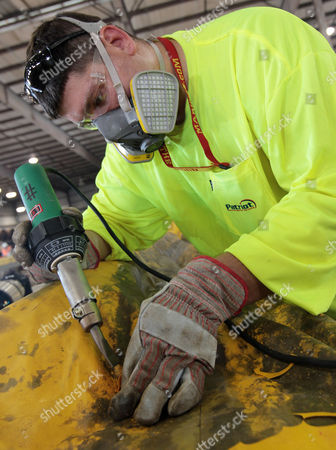 Jeremy Reed supervises oil boom decontamination work at the Theodore Staging Area in Theodore, Ala., . Oil from the Deepwater Horizon disaster continues to wash ashore along the Alabama and Florida coasts and the facility makes repairs to booms around the clock