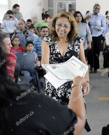 Veronica Hernandez Veronica Hernandez smiles as she receives her certificate of naturalization during a special naturalization ceremony for 118 new citizens at the U.S. Citizenship and Immigration Services office in Irving, Texas