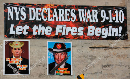 Signs are posted on a bridge on the Tonawanda Seneca Nation in New York. Tensions are rising as the state nears the Sept. 1 start date to collect taxes on cigarettes sold by Indian tribes. The photo at left depicts New York Gov. David Paterson, while the photo at right depicts New York Mayor Michael Bloomberg