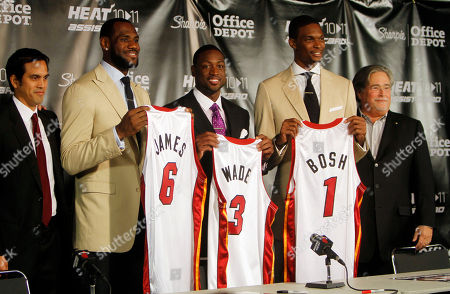 Erik Spoelstra, LeBron James, Dwyane Wade, Chris Bosh Micky Arison From left, Miami Heat head coach Erik Spoelstra, LeBron James (6), Dwyane Wade (3), Chris Bosh (1) and owner Micky Arison attend a news conference at the American Airlines Arena in Miami on