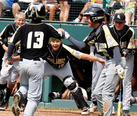 Jacob Jones Hamilton, Ohio's Jacob Jones (13) is greeted by teammates after hitting a two-run home run off Toms River, N.J. pitcher Joey Rose in the first inning of a baseball game during pool play at the Little League World Series in South Williamsport, Pa., . Ohio won 16-6