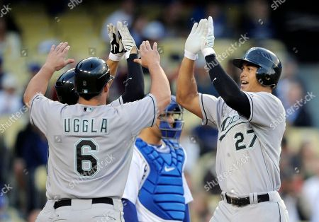 Mike Stanton, Russell Martin, Dan Uggla Florida Marlins' Mike Stanton, right, is congratulated by teammate Dan Uggla after Statnton hit a three-run home run in the second inning of their baseball game, in Los Angeles