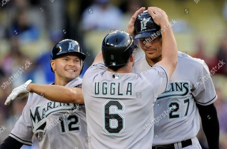 Mike Stanton, Cody Ross, Dan Uggla Florida Marlins' Mike Stanton, right, is congratulated by teammate Dan Uggla and Cody Ross, left, after hitting a three-run home run during the second inning of their baseball game against the Los Angeles Dodgers, in Los Angeles