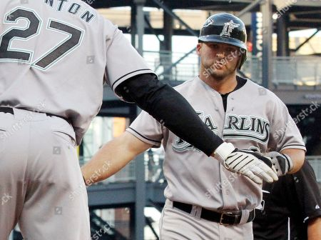 Dan Uggla Florida Marlins' Dan Uggla, right, crosses home plate to greetings from Mike Stanton (27) after hitting a solo home run off Pittsburgh Pirates pitcher Ross Ohlendorf in the first inning of a baseball game in Pittsburgh on . The Marlins won 3-2