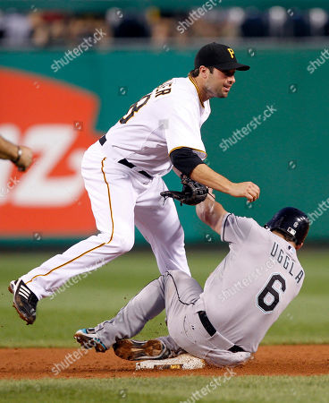 Dan Uggla Neil Walker Florida Marlins' Dan Uggla, right, slides into Pittsburgh Pirates second baseman Neil Walker after being forced out at second on a double play on a ground ball my Marlins' Mike Stanton in the sixth inning of the baseball game in Pittsburgh