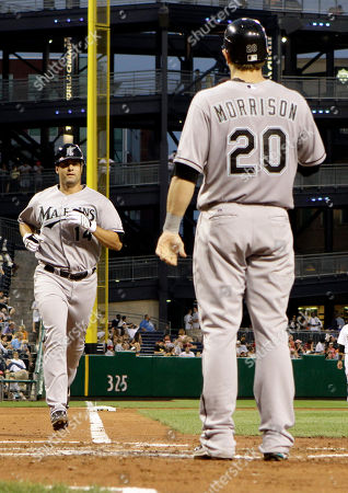 Gaby Sanchez Florida Marlins' Gaby Sanchez, left, heads home to be greeted by teammate Marlins' Logan Morrison after hitting a three-run home run in the sixth inning of the baseball game against the Pittsburgh Pirates in Pittsburgh