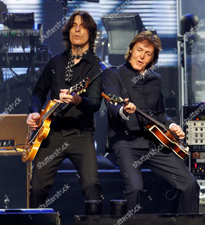 Paul McCartney, Rusty Anderson Paul McCartney, right, jams with lead guitarist Rusty Anderson during the first show at the new CONSOL Energy Center in Pittsburgh