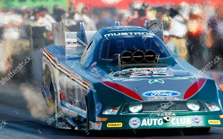 John Force NHRA driver John Force drives during qualifying for the NHRA Fram Autolite Nationals drag races, at Infineon Raceway in Sonoma, Calif