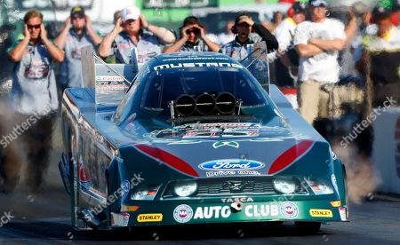 John Force John Force races during Funny Car qualifying for the NHRA Fram Autolite Nationals drag races, at Infineon Raceway in Sonoma, Calif