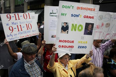 People participate in a rally against a proposed Islamic center and mosque near ground zero in New York. New York Assembly Speaker Sheldon Silver, who represents the lower Manhattan district, joined Gov. David Paterson, in suggesting that Islamic leaders should move the proposed Islamic center and mosque farther from ground zero, saying the organizers should be more sensitive to opponents