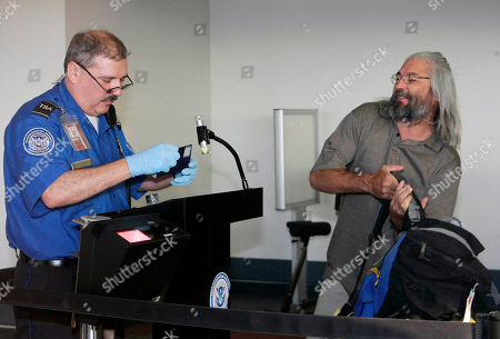 Gary Faulkner Gary Faulkner, right, gets his papers check by an unidentified TSA airport security official as he checks in Wednesday afternoon, after arriving at Los Angeles International Airport, in Los Angeles. Faulkner on a solo mission to hunt down Osama bin Laden is back in the United States, 10 days after authorities found him in the woods of northern Pakistan with a pistol, a sword and night-vision equipment