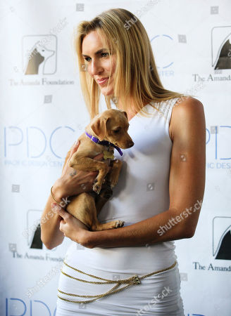 """Holly Ridings Model Holly Ridings from the television show Project Runway arrives at the Pacific Design Center prior to taking part prior to taking part in the """"Patterns for Paws"""" charity dog fashion show, benefitting The Amanda Foundation, in West Hollywood, Calif. on"""