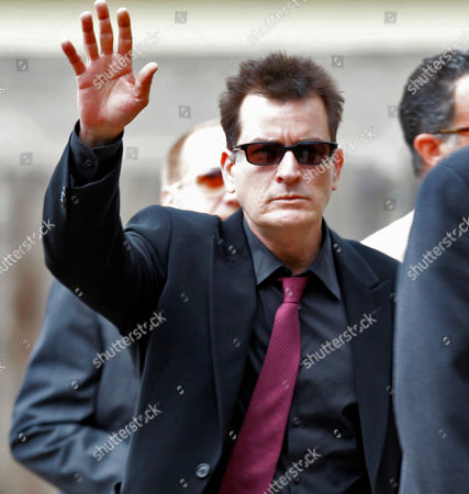 """Stock Picture of Charlie Sheen Charlie Sheen waves as he arrives at the Pitkin County Courthouse in Aspen, Colo., for a hearing in his domestic abuse case. Appearing on ABC's """"Good Morning America"""", adult-film actress Capri Anderson, the woman found in Charlie Sheen's New York hotel room last month, says the actor hurled racial slurs, threw a lamp at her and grabbed her by the throat. She says she's suing Sheen for battery and false imprisonment, and plans to file a criminal report with New York police"""