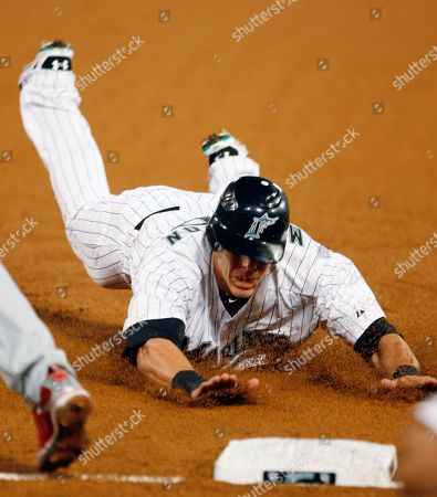 Logan Morrison Florida Marlins' Logan Morrison slides safely into third base on a base hit by Gaby Sanchez against the Philadelphia Phillies in the first inning of a baseball game in Miami