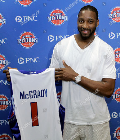 Tracy McGrady Detroit Pistons guard Tracy McGrady holds his jersey during a news conference in Auburn Hills, Mich