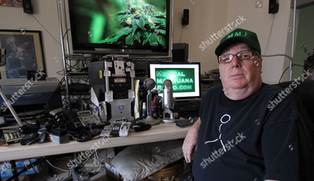 Larry Love Medical marijuana patient Larry Love poses in front of his podcasting equipment in his home studio in Santa Fe, N.M., on . Love runs an online radio blog and has been critical of the New Mexico Department of Health, which he contends approves new medical marijuana growers much too slowly