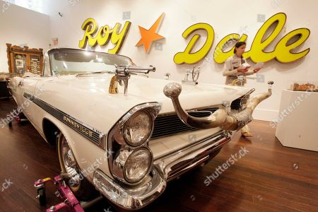 The 1963 Pontiac Bonneville parade car of movie cowboy Roy Rogers is displayed at Christies auction house in New York, . Christie's held a preview Friday of an upcoming auction of items from the now-closed Roy Rogers and Dale Evans Museum in Branson, Mo