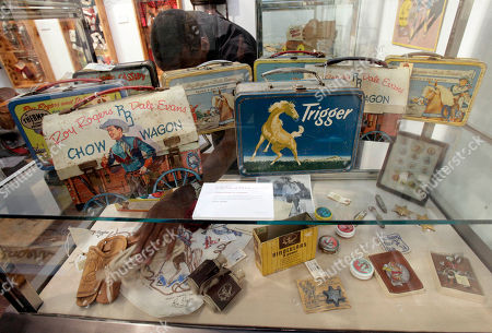 Stock Photo of An employee of Christies auction house takes inventory of some of the belongings of movie cowboy Roy Rogers, in New York, . Christie's held a preview Friday of an upcoming auction of items from the now-closed Roy Rogers and Dale Evans Museum in Branson, Mo