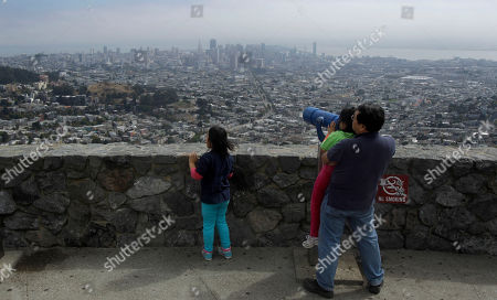 San Francisco Tourists From Ashburn, Va., Daniel Hahn lifts his daughter Joyce, 7, up to a telescope as his other daughter Eunice, 9, looks onto San Francisco from Twin Peaks on