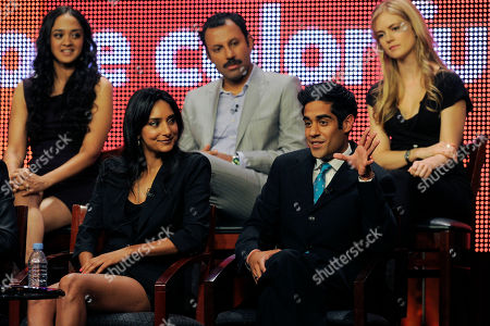 """Stock Image of Rebecca Hazelwood, Anisha Nagarajan, Rizwan Manji, Pippa Black, Sacha Dhawan Sacha Dhawan, bottom right, a cast member in """"Outsourced,"""" answers a question as fellow cast members, clockwise fellow cast members, clockwise from foreground left, Rebecca Hazelwood, Anisha Nagarajan, Rizwan Manji and Pippa Black, look on during a panel discussion on the show at the NBC Universal Television Critics Association summer press tour in Beverly Hills, Calif., in Los Angeles"""