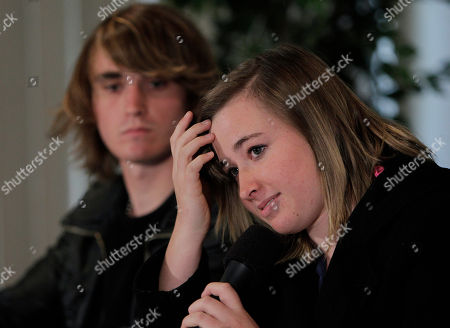Abby Sunderland, the 16-year-old girl who attempted to sail around the world, listens to a question as she is joined by her brother Zac during a news conference in Marina Del Rey, Calif., . Sunderland was rescued by a French fishing boat after her boat became crippled by storms while trying to become the youngest person to circumnavigate the globe solo and nonstop