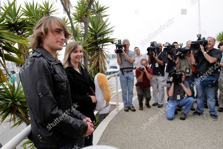 Abby Sunderland, who attempted to sail around the world, and her brother Zac, left, pose for photos after a news conference in Marina Del Rey, Calif., . Sunderland was rescued by a French fishing boat after her boat became crippled by storms while trying to become the youngest person to circumnavigate the globe solo and nonstop