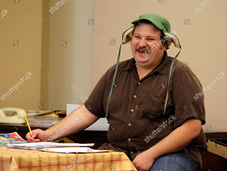 """Stock Image of Aaron Munoz Actor Aaron Munoz, who plays Ignatius, shares a laugh with other cast members as they work to refine the script for """"A Confederacy of Dunces'' in Atlanta. Atlanta's Theatrical Outfit is taking advantage of an opportunity to stage """"A Confederacy of Dunces'' with a new adaptation of the Pulitzer Prize-winning novel"""
