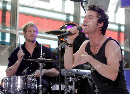 """Pat Monahan, Scott Underwood Pat Monahan, right, lead singer and drummer Scott Underwood, of the group Train, perform with the band on the NBC """"Today"""" television program in New York"""