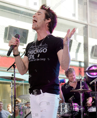 """Pat Monahan, Scott Underwood Pat Monahan, left, lead singer and drummer Scott Underwood, of the group Train, perform with the band on the NBC """"Today"""" television program in New York"""