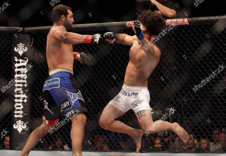 Charlie Brenneman, Johny Hendricks Johny Hendricks, left, competes with Charlie Brenneman during a UFC mixed martial arts match in Oakland, California, . Hendricks won by TKO in the second round