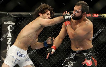 Charlie Brenneman, Johny Hendricks Johny Hendricks, right, competes with Charlie Brenneman during a UFC mixed martial arts match in Oakland, California, . Hendricks won by TKO in the second round