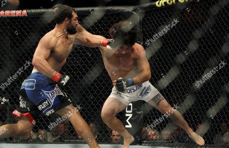 Johny Hendricks, Charlie Brenneman Johny Hendricks, left, punches Charlie Brenneman during a UFC mixed martial arts match in Oakland, Calif., . Hendricks won by TKO in the second round