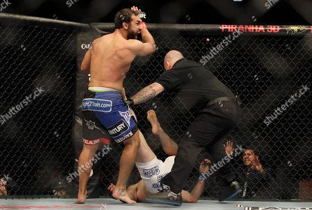 Charlie Brenneman, Johny Hendricks Johny Hendricks, top, competes with Charlie Brenneman during a UFC mixed martial arts match in Oakland, California, . Hendricks won by TKO in the second round