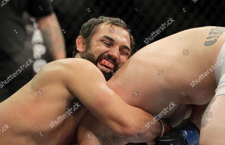 Charlie Brenneman, Johny Hendricks Johny Hendricks, left, wrestles with Charlie Brenneman during a UFC mixed martial arts match in Oakland, California, . Hendricks won by TKO in the second round