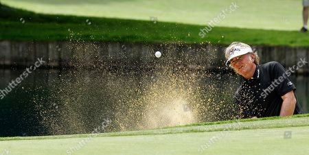 Stock Photo of Tommy Armour III Tommy Armour III hits out of a bunker at the ninth green in the third round of the U.S. Senior Open golf tournament, at Sahalee Country Club in Sammamish, Wash
