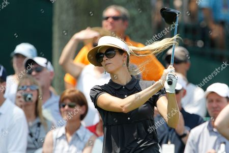 Stock Image of Anna Rawson Anna Rawson of Australia follows through on her drive off the tenth tee during a practice round at the U.S. Women's Open at Oakmont Country Club in Oakmont, Pa