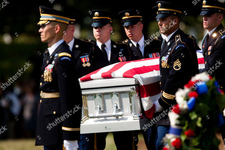 Soldiers from the U.S. Army's 3rd Infantry Regiment Old Guard carry the casket containing the co-mingled remains of Pvt. Robert Crane, Pfc. Richard M. Dawson, Pvt. Fred G. Fagan, Tech. Sgt. Clarence E. Frantz, Capt. Joseph M. Oblinski, and Lt. Robert M. Anderson, at Arlington National Cemetery, in Arlington, Va., . The men were aboard a C-47A Skytrain that left India on May 23, 1944, to resupply Allied forces near Myitkyina in Burma, now known as Myanmar, but never returned