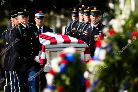 Soldiers from the U.S. Army's 3rd Infantry Regiment Old Guard, carry the casket containing the co-mingled remains of Pvt. Robert Crane, Pfc. Richard M. Dawson, Pvt. Fred G. Fagan, Tech. Sgt. Clarence E. Frantz, Capt. Joseph M. Oblinski, and Lt. Robert M. Anderson, at Arlington National Cemetery, in Arlington, Va., . The men were aboard a C-47A Skytrain that left India on May 23, 1944, to resupply Allied forces near Myitkyina in Burma, now known as Myanmar, but never returned