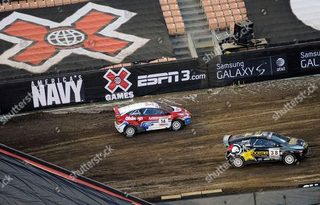 Stock Image of Brian Deegan, Kenny Brack Brian Deegan, right, passes Kenny Brack during the X Games Rally Car SuperRally on at X Games 16 in Los Angeles