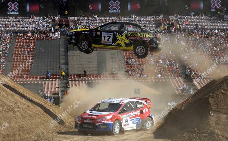 Antoine L'Estage, Kenny Brack Antoine L'Estage of Canada takes a jump over Kenny Brack during the Rally Car Racing final on at X Games 16 in Los Angeles