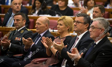 Stock Photo of Croatian president Kolinda Grabar-Kitarovic, center and outgoing prime minister Tihomir Oreskovic, center right, applaud as Croatian Parliament convenes in Zagreb, Croatia, . The ninth 151-member Croatian Parliament was inaugurated following the Sept. 11, 2016 snap election