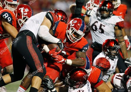 Ryan Dunn, Dontel James San Diego State's Ryan Dunn wraps up Fresno State's Dontel James with strong defense during the second half of an NCAA college football game in Fresno, Calif