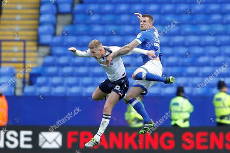 Bolton's Mark Davies and Oldham's Peter Clarke  during the EFL Sky Bet League 1 match between Bolton Wanderers and Oldham Athletic at the Macron Stadium, Bolton