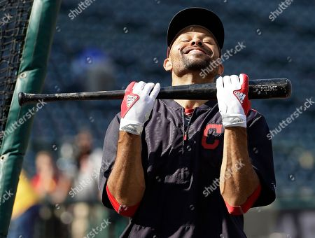 Cleveland Indians left fielder Coco Crisp jokes around during batting practice before Game 2 of baseball's American League Championship Series against the Toronto Blue Jays in Cleveland