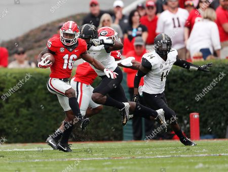 Isaiah McKenzie, Mack Weaver, Ryan White Georgia wide receiver Isaiah McKenzie (16) looks for running room after a catch as Vanderbilt's Mack Weaver (8) and Ryan White (14) give chase in the first half of an NCAA college football game, in Athens, Ga