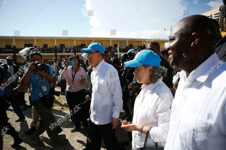 U.N. Secretary-General Ban Ki-moon, center, walks with his wife Yoo Soon-taek as they visit a school sheltering people whose homes were destroyed by Hurricane Matthew in Les Cayes, Haiti, . Ban Ki-moon arrived to see firsthand a sliver of the extensive destruction left by the storm as victims continued to express frustration at delays in aid more than a week-and-a-half since the Category 4 storm hit