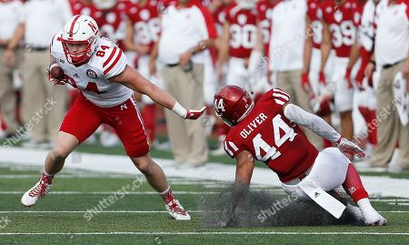 Sam Cotton, Marcus Oliver Nebraska tight end Sam Cotton (84) shrugs off Indiana linebacker Marcus Oliver (44) on a catch during the first half of an NCAA college football game in Bloomington, Ind