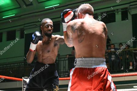 Stock Image of Marcus Williams (black shorts) defeats Mitch Mitchell during a Boxing Show at York Hall on 15th October 2016